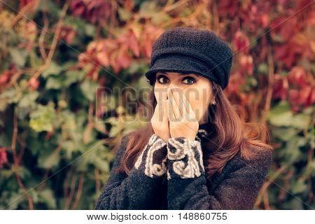 Cute Girl with Autumn Seasonal Allergies Sneezing