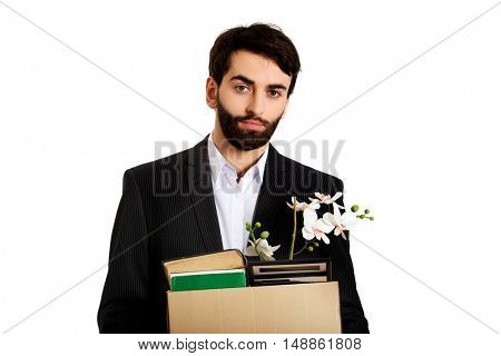 Businessman holding box with personal belongings.