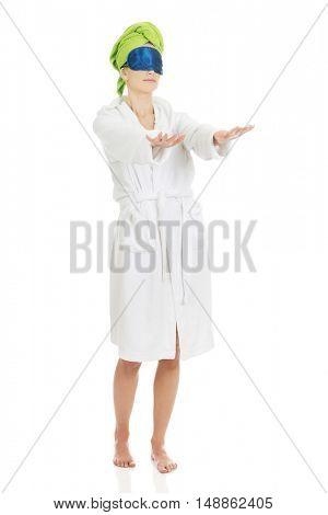 Sleepwalking woman in bathrobe.