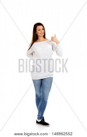 Young woman making a call me gesture