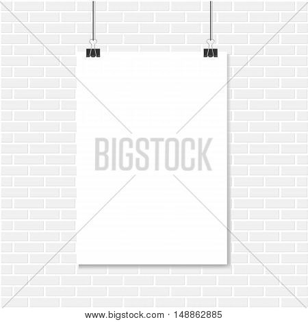 White brick wall and vertical realistic poster mockup A4 on a rope