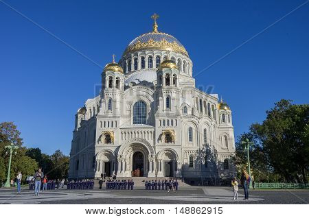 Kronstadt, Russia- September 13, 2016: Naval Cathedral of St. Nicholas and the square with tourists and young naval cadets in Kronstadt at Sunny day