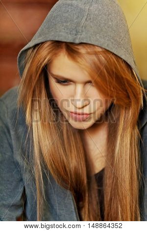 Teenage woman sitting stairscase and smoking