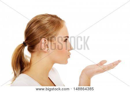 Young woman sending a kiss