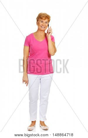 Smiling senior woman talking through phone