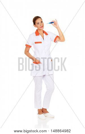 Young female doctor or nurse holding thermometer