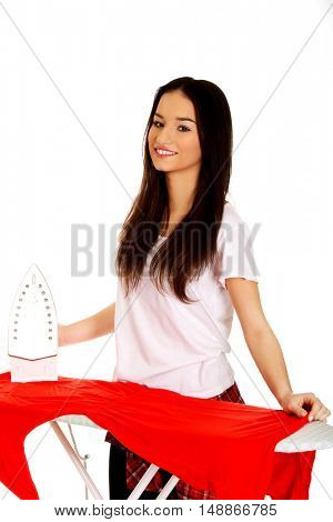Young woman do the ironing.