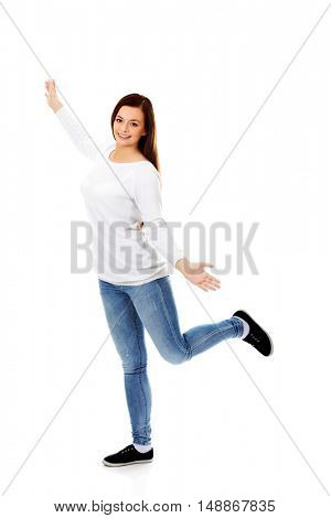Happy dancing teenager with arms up