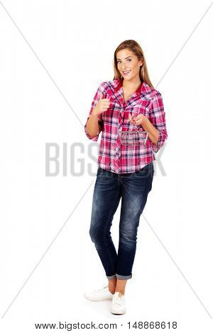 Young woman holding small shopping basket