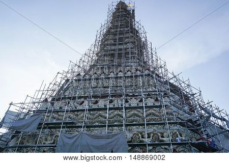 Pagoda in Wat Arun under construction with daylight