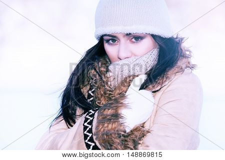 Young beautifull woman on the winter background
