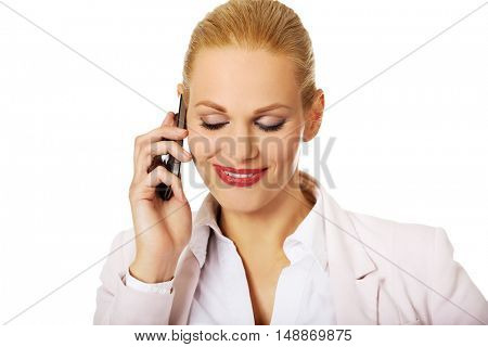 Smiling business woman talking through the phone