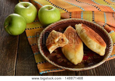 Hor patty with green apples on wooden table