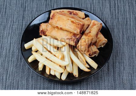 Deep fried spring roll and French fries served are food for Chinese Vegetable festival of Chinese as