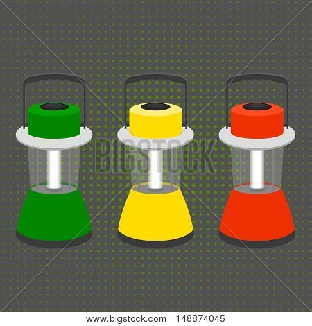 three large desktop flashlight in the colors of a traffic light