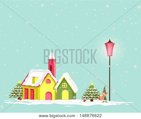 Creative colorful houses on winter background for Merry Christmas celebration.