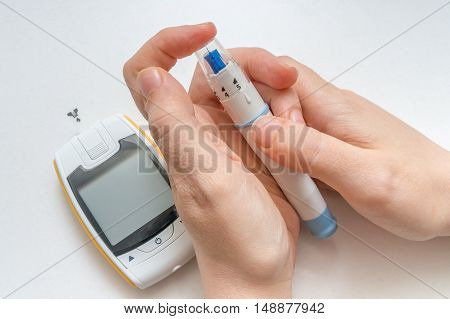Diabetes Concept. Diabetic Patient Is Making Blood Glucose Level