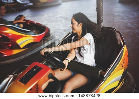 Girl Driving Bumper Car Happiness Enjoyment Concept