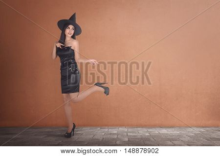 Pretty Young Happy Woman Smiling And Dressed As A Witch