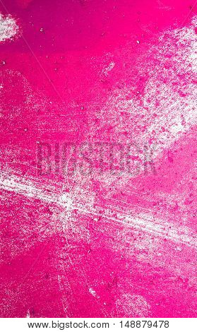 Pink painted wall paper texture background may use as abstract background.