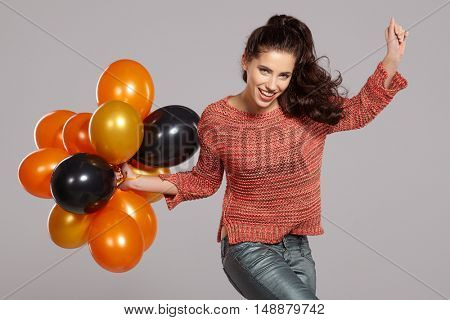 Young pretty woman with colored balloons