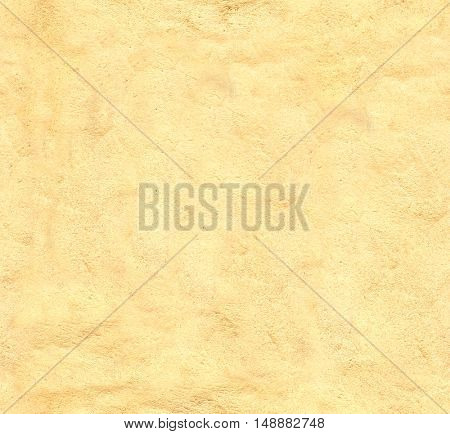 Grunge background - seamless texture stucco of yellow color