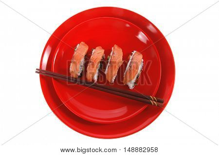 onigiri inside out sashimi shushi with raw salmon and sticks on red plate isolated over white background