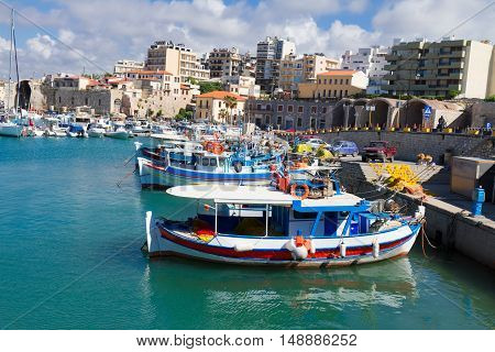 Heraklion old town port with colorful greek boats at sunny day, Crete, Greece