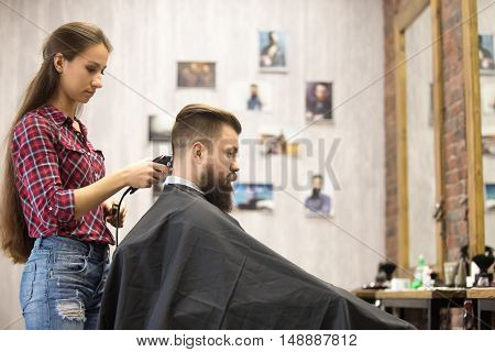 Barber Woman Serving Client In Barbershop