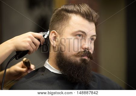 Young Bearded Man In Hairdresser Salon