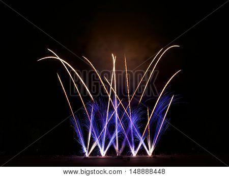 Artistic fireworks. Famous Vilnius fireworks festival. Fireworks fan. Explode. New Year celebration. 4 July. Holidays background
