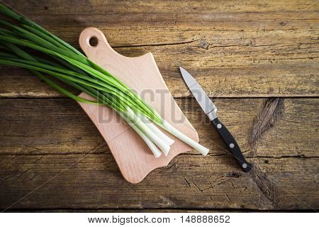 Green Onion On Wood Background. Food And Drink