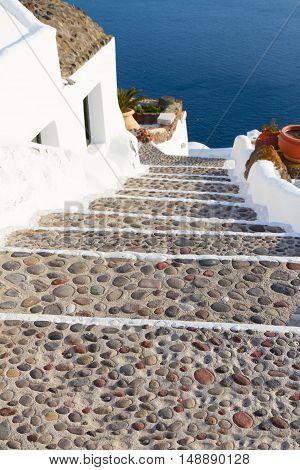 steep stone stairs to the deep blue sea, beautiful details of Santorini island, Greece
