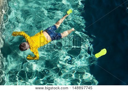 body of a boy in the pool, outdoors
