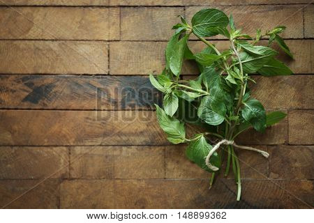 Bunch of fresh mint on wooden background, top view