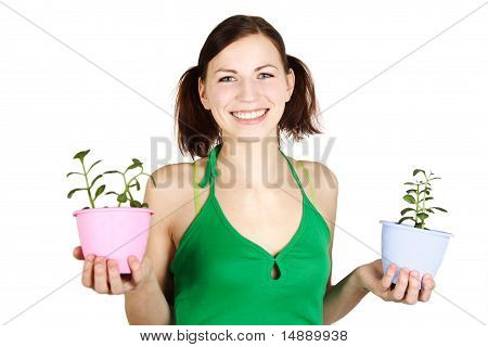 Young Girl In Green Shirt Holding Potted Plants And Smiling, Isolated