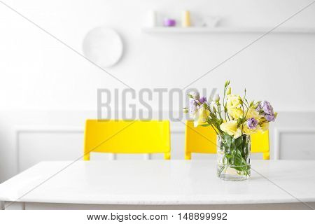 Bouquet of fresh eustoma flowers on table