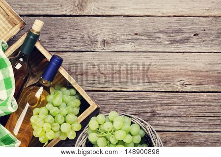 White wine and grapes on wooden table. Top view with copy space for your text. Toned