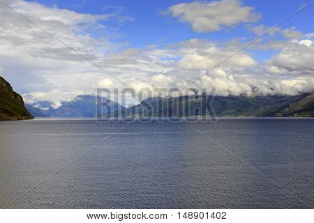 It is Hardangerfjord in south-western Norway surrounded by rocky mountains is by third longest in the world and the second in the country.