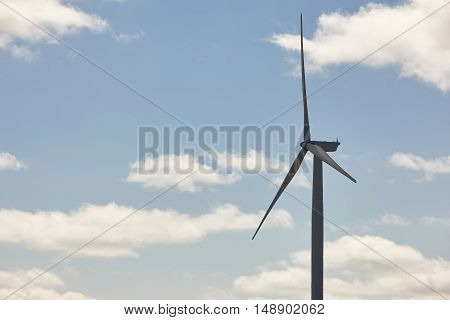 Wind turbine in the countryside. Clean alternative renewable energy. Horizontal