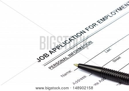 A photo of Job application and pen on isolate white background Selective focus Soft focus