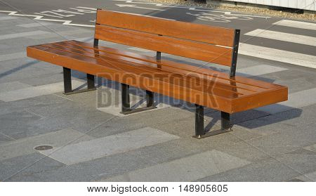 wooden bench in a public place in town