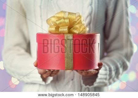 Female hands holding christmas present