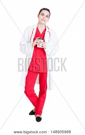 Full Body Of Woman Medic Enjoying Fresh Coffee
