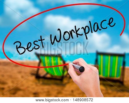 Man Hand Writing Best Workplace With Black Marker On Visual Screen