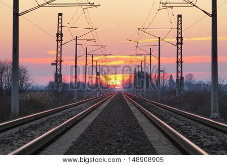 Railroad - Railway at sunset with  a sun.