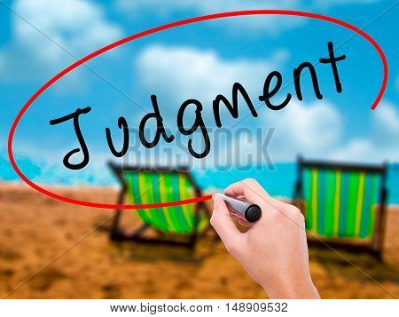 Man Hand Writing Judgment With Black Marker On Visual Screen