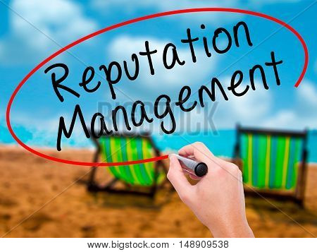 Man Hand Writing Reputation Management With Black Marker On Visual Screen