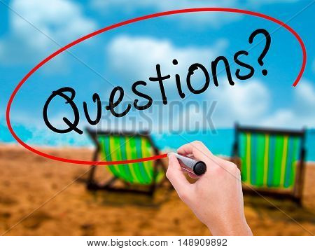 Man Hand Writing Questions? With Black Marker On Visual Screen
