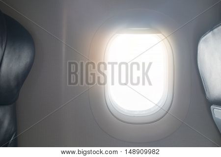 empty porthole and place for text in airplane